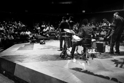 Black-and-white image of a jazz band playing a concert